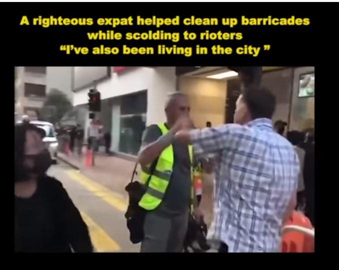 Proteste in Hongkong: Swiss Re-Manager zerlegt  Barrikade von Demonstranten